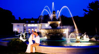 Couple sitting outside the Wylie Inn Fountain at night