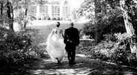 Black and white photo of Bride and Groom leaving wedding