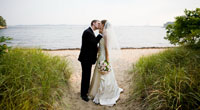 Bride and Groom kissing on beach during the day
