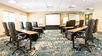 meeting tables arranged in  IACC room